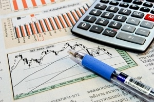 Investing confidence: calculator, pen and charts used to seek opportunity in market dip.